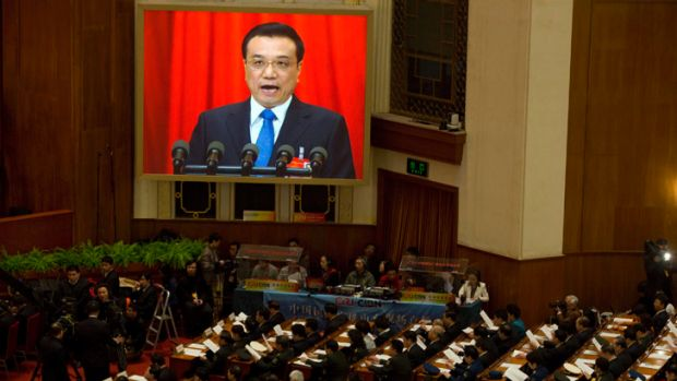 Chinese Premier Li Keqiang delivers a work report during the opening session of the annual National People's Congress in ...