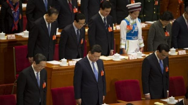 Respect: Chinese leaders including President Xi Jinping (front row, centre) and Premier Li Keqiang (front row, right) ...