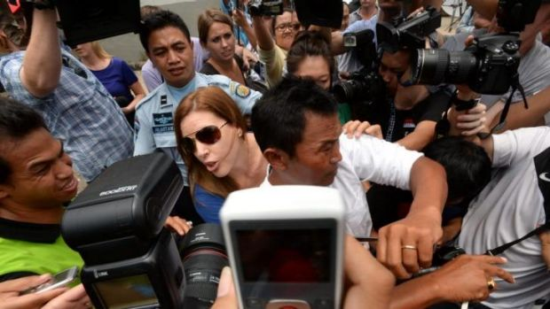 Schapelle's sister Mercedes and husband Wayan fight their way through the media pack after visiting Shapelle in prison ...