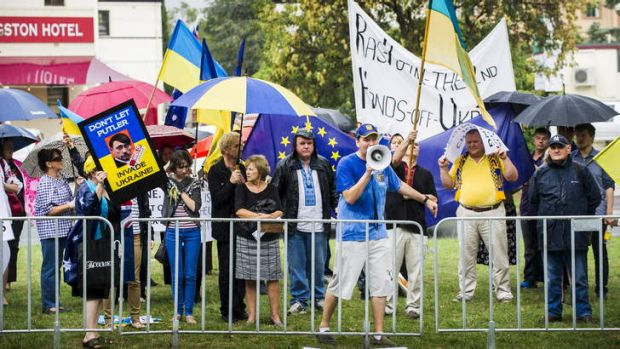 TAKING A STAND: Protesters rally outside the Russian embassy in Canberra. Ukrainian visitors will be allowed to stay ...