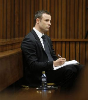 Taking notes: Oscar Pistorius in court.