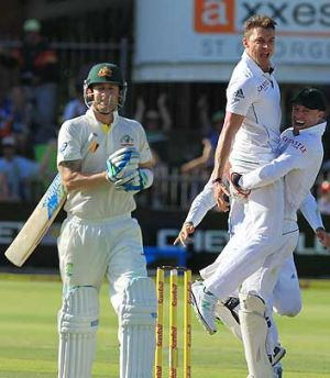 Dale Steyn celebrates with teammate AB de Villiers, right, after dismissing Michael Clarke in Port Elizabeth, South ...