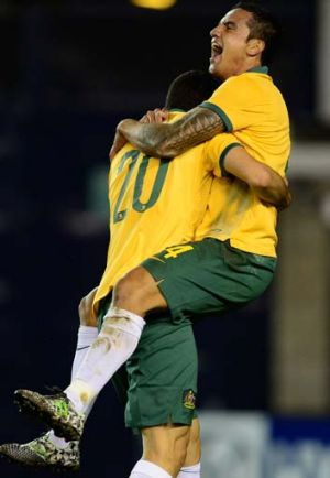 Tim Cahill of Australia celebrates a goal in the first half.
