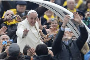 Mass appeal ... Pope Francis greets the crowd as he arrives at St Peter's square on January 22, 2014 at the Vatican.