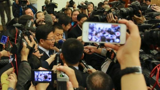 Huge interest ... Chinese Communist Party leader of Xinjiang, Zhang Chunxian, is met by a media scrum after he defended ...