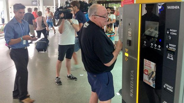 John Chardon arrives at Brisbane airport after an overseas business trip.