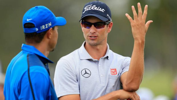 Up for grabs: Adam Scott is contention to snare the world No.1 crown from playing partner Tiger Woods.