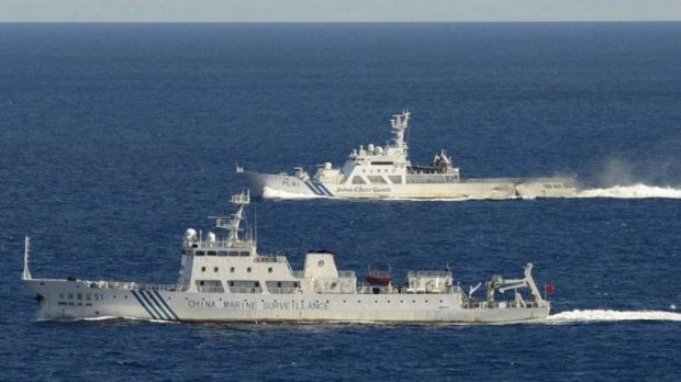 Chinese marine surveillance ship Haijian No. 51 (front) cruising as a Japan Coast Guard ship sails near the disputed ...