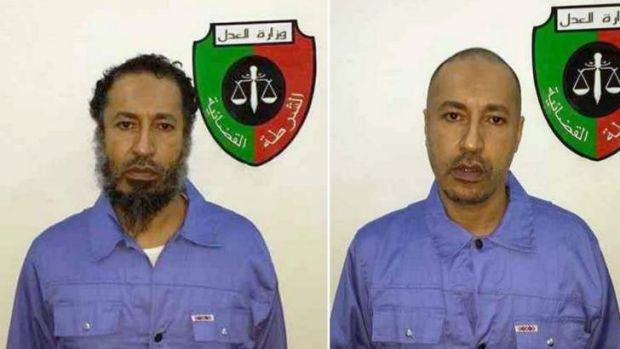 In custody: al-Saadi Gaddafi, son of the fallen Libyan dictator Muammar Gaddafi, is seen with the seal of Libya's ...