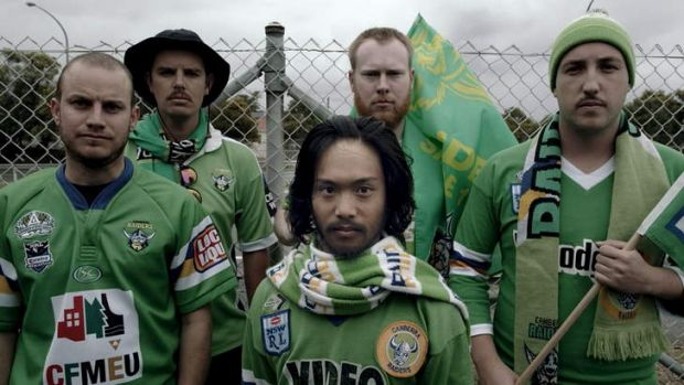 A screen shot from the NRL You're the Difference ad with Raiders fans Mat Casey and Stephen O'Rourke ( at the back) and ...