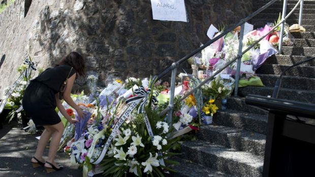 Flowers on stairs on Albert street before a memorial Service held for the late Eunji Ban in Wickham Park in ...