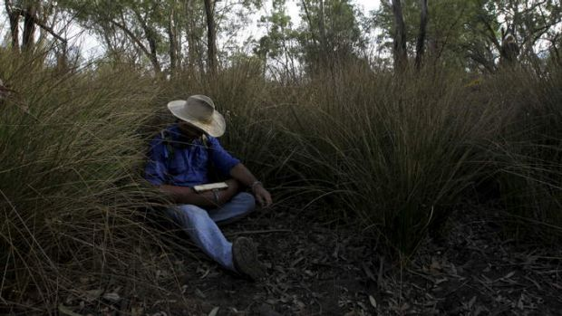 In waiting: Grazier and protester Ted Borowski lies in a dry creek bed ready to disrupt drilling operations in the ...