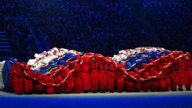 Dancers form a 'fluttering' Russian flag during the opening ceremony.