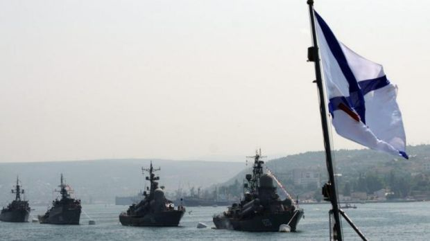 Critical base for Putin ... Russian Black Sea Navy ships anchored in Sevastopol Bay with a Russian naval flag (R) flying ...