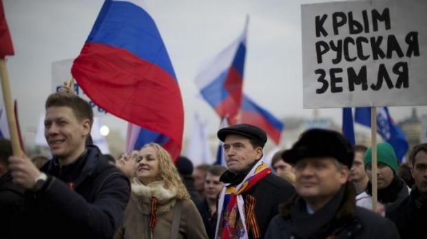 Nationalists ... Pro-Putin demonstrators with St. George ribbons hold Russian national flags and posters reading 'Crimea ...