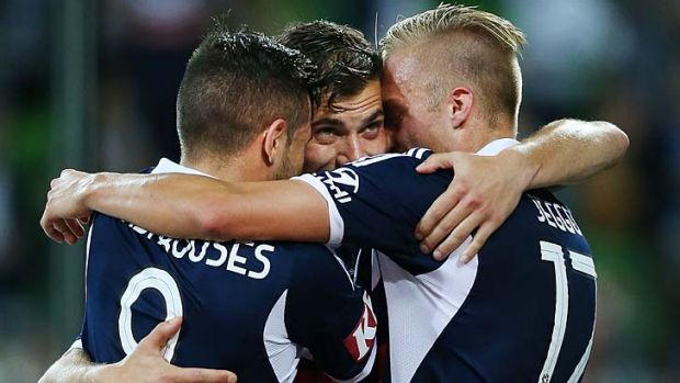 James Troisi (centre) of the Victory celebrates a penalty goal with James Jeggo (right) and Kostas Barbarouses.