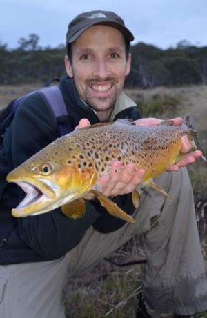 Graham Fifield shows of a trout.