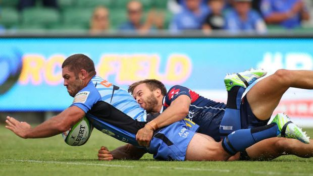 Matt Hodgson of the Force crosses for a try.
