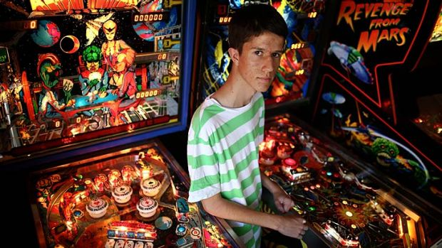 Game time: Nick Dawtrey at home with two of his 10 pinball machines.