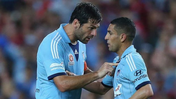 Tense times: SYdney FC midfielder Ali Abbas (right) being spoken to by teammate Sasa Ognenovski during Saturday night's ...