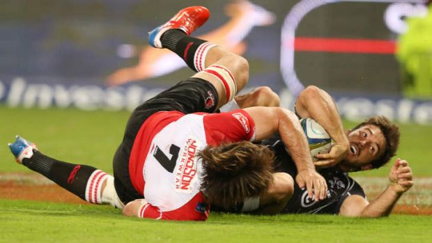 Paul Jordaan crashes over for another try for the Sharks.