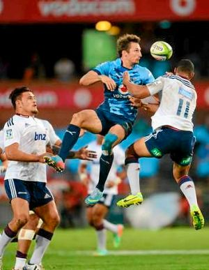 Bombs away: Jurgen Visser of the Bulls and Tevita Li of the Blues vie for a high ball.