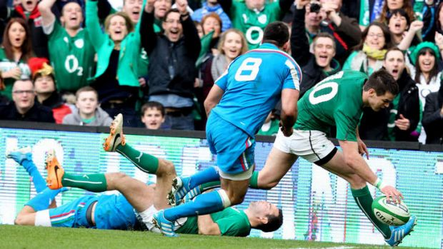 Jonathan Sexton scores a try out wide for Ireland.
