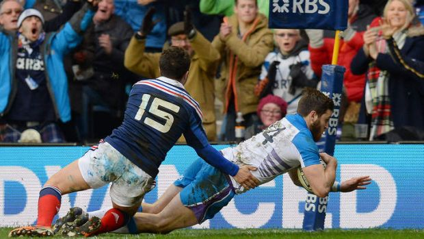 Tommy Seymour crashes over in the corner for Scotland.