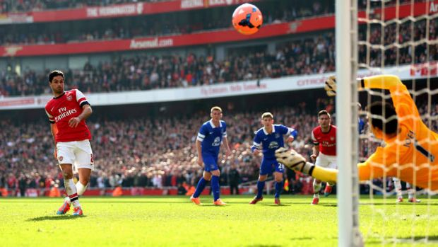 Mikel Arteta of Arsenal scores from the penalty spot.