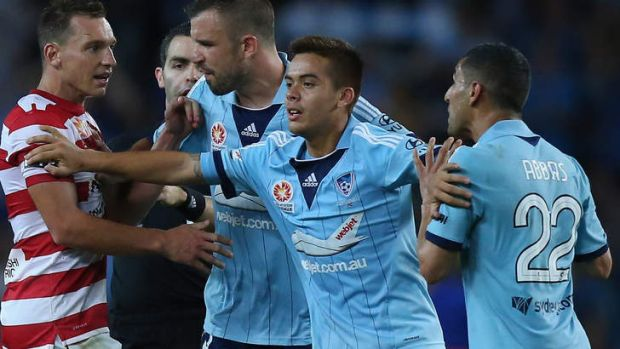 Angry words: Hagi Gligor places himself between Sydney FC teammate Ali Abbas and Brendon Santalab of the Wanderers  at ...