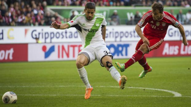 Bayern Munich's midfielder Xherdan Shaqiri swoops on the ball ahead of  Wolfsburg's defender Ricardo Rodriguez.