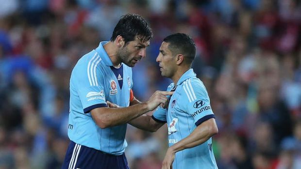 Sasa Ognenovski (L) of Sydney FC tries to calm down his team-mate Ali Abbas, who claims he was the victim of racist abuse.