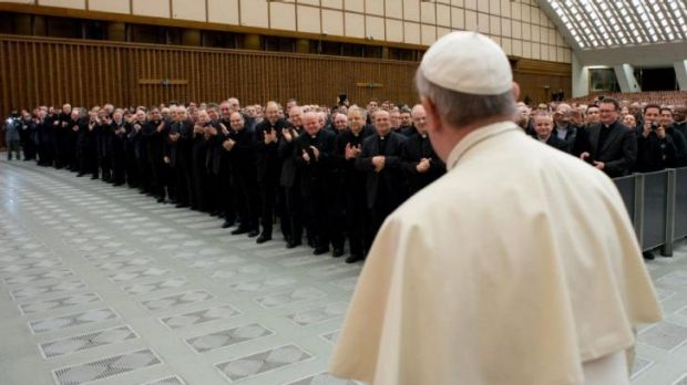 Pope Francis arrives for a meeting with Roman priests at the Vatican on Thursday. He has named top financial laymen to a ...