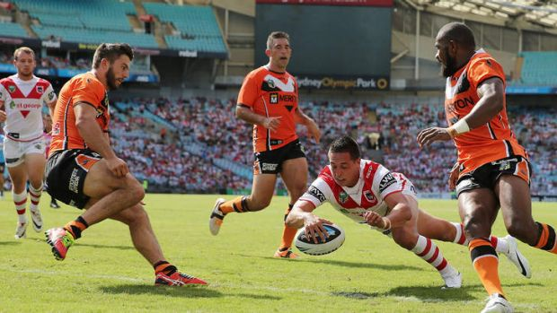 Dragons centre Gerard Beale touches down against the Tigers.