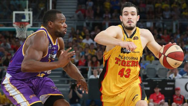 Melbourne's Chris Goulding drives to the basket while being defended by Kings import Sam Young.