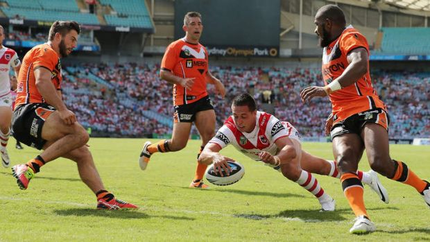Strong start: Gerard Beale scores a try for the Dragons against the Tigers on Sunday.