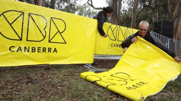 Events ACT staff Vanessa Febo and John Leahy set up for Canberra Day celebrations.