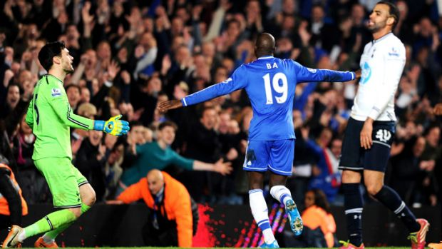 Cheslea's Demba Ba wheels away in delight after scoring his team's third goal against Tottenham.