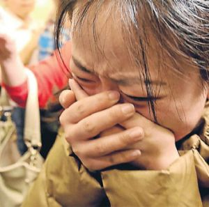 A relative of a passenger is grief-stricken at a Beijing hotel where families had gathered to wait for news.