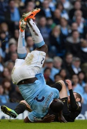 Tumbling in: Manchester City's defender Micah Richards is tackled by Wigan's midfielder Chris McCann.