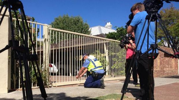 Police arrived at Troy Buswell's home to photograph the crash site.
