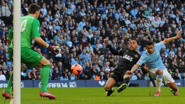 Deja vu: James Perch scores Wigan's second goal to set up the upset victory over Manchester City.