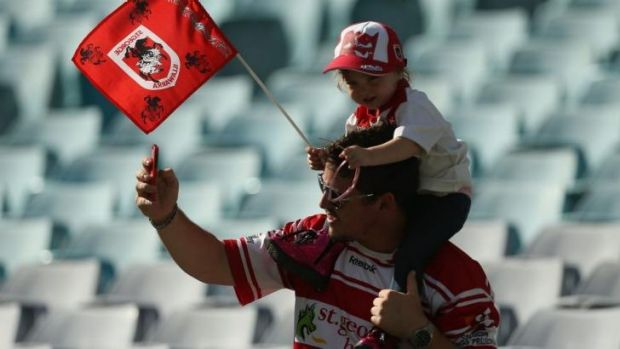 Flying the flag: Low crowds over the first round may have worried some NRL types, but these Dragons fans would have been ...