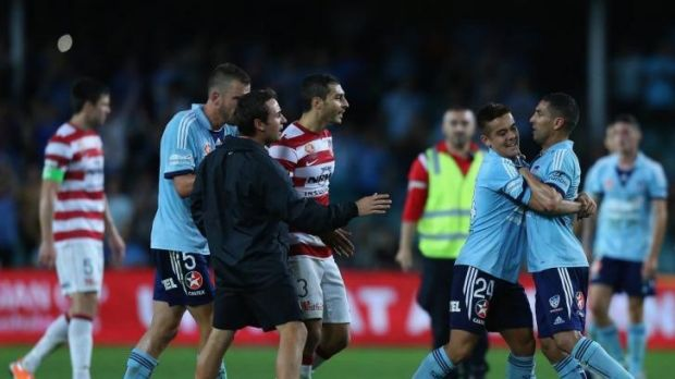 All fired up: Hagi Gligor, second from left, restrains Ali Abbas during Saturday's A-League Sydney derby during which ...