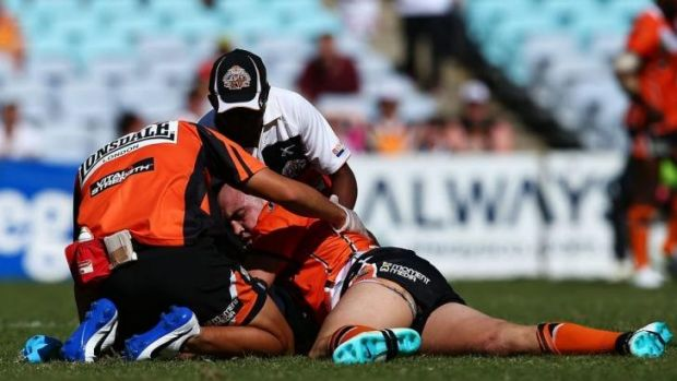 Concussed: Liam Fulton of Wests Tigers had to be stretchered off against St George Illawarra.