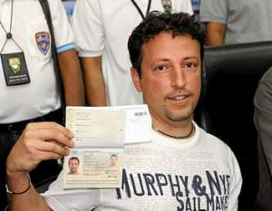 Italian Luigi Maraldi, whose stolen passport was used by a passenger boarding a missing Malaysian airliner, shows his ...