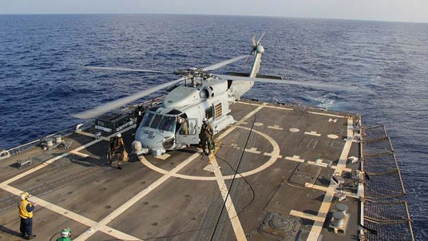 Ocean watch: A US Navy helicopter aboard destroyer USS Pinckney taking part in the search and rescue mission in the Gulf ...