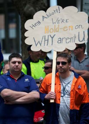 Large job losses: Union workers protest against the government decision not to continue subsidising Holden in Australia.