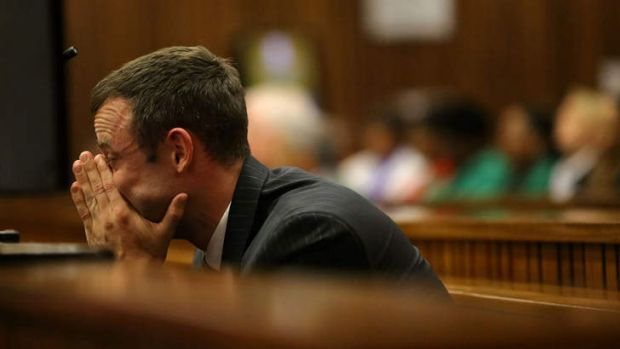 A pale-looking Oscar Pistorius sits in the dock as he listens to questioning about the events surrounding the shooting ...