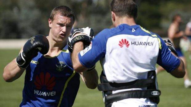 Canberra Raiders player Jack Wighton, left, boxing during pre-season training at Raiders headquarters.